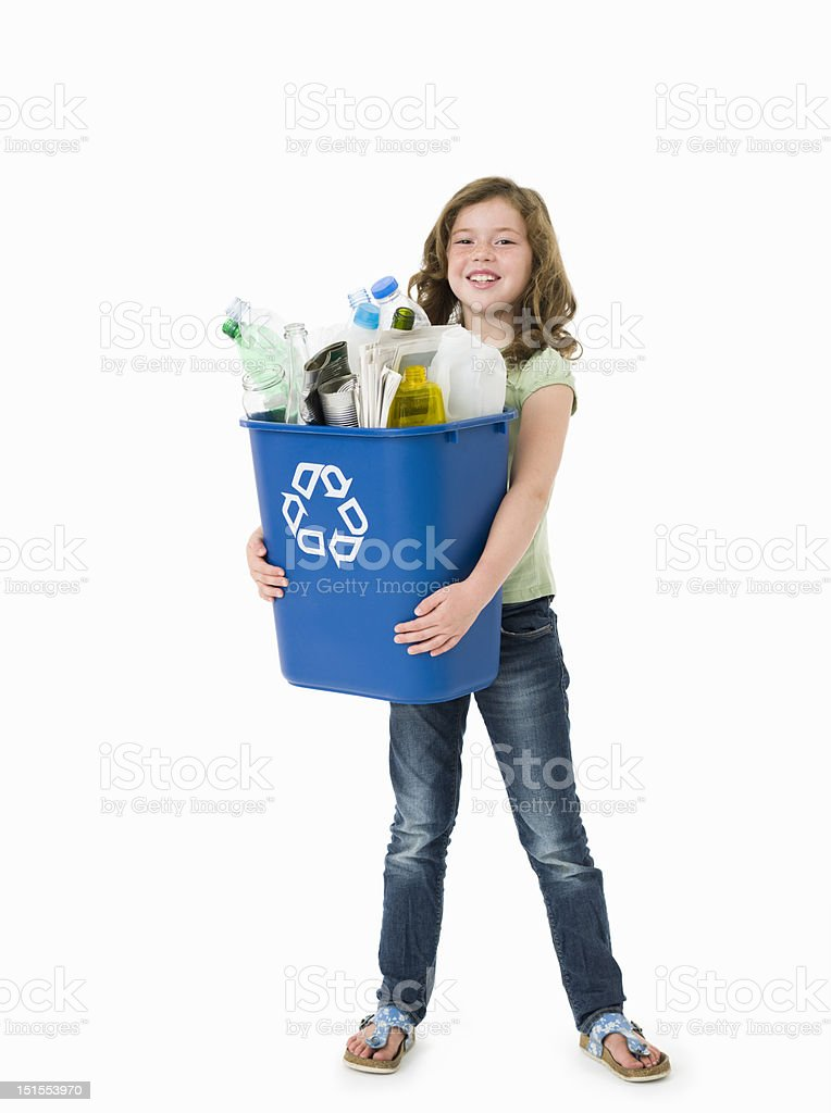 Pretty young girl holding blue recycle bin on white background stock photo