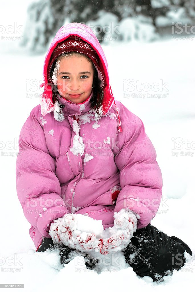 Pretty young girl in the snow royalty-free stock photo