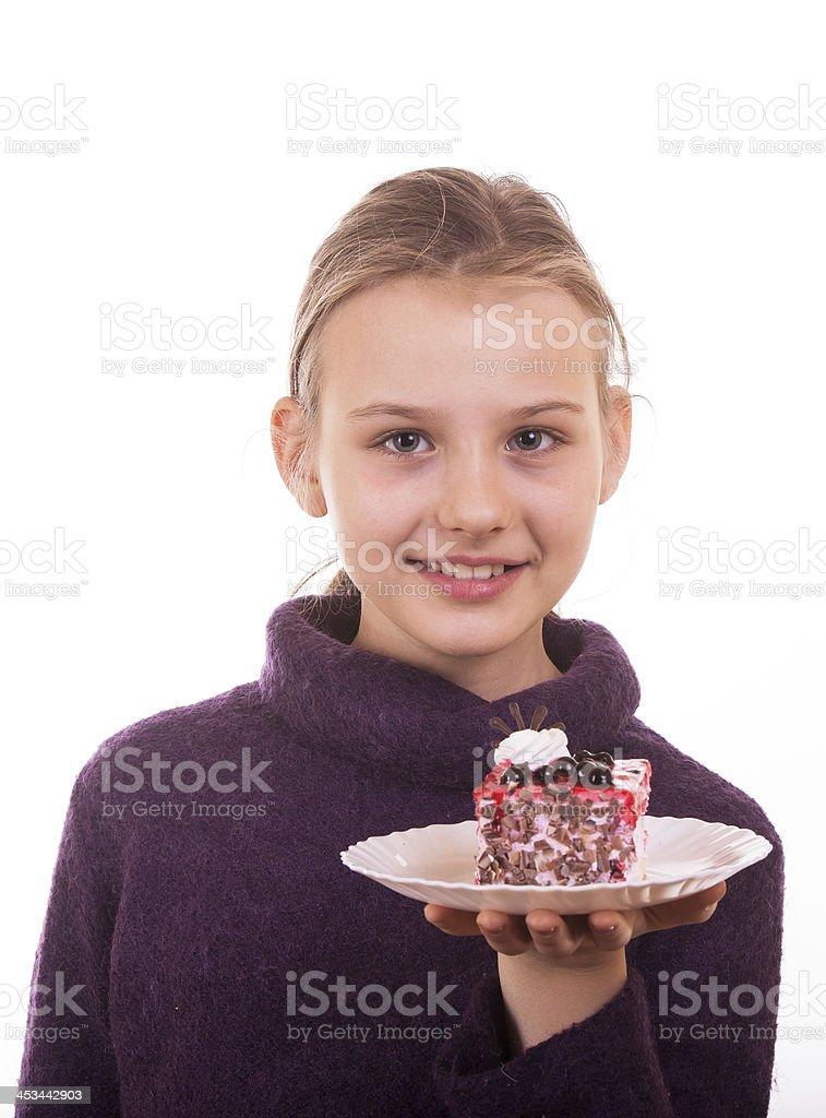 Pretty young girl looking at cake on white royalty-free stock photo