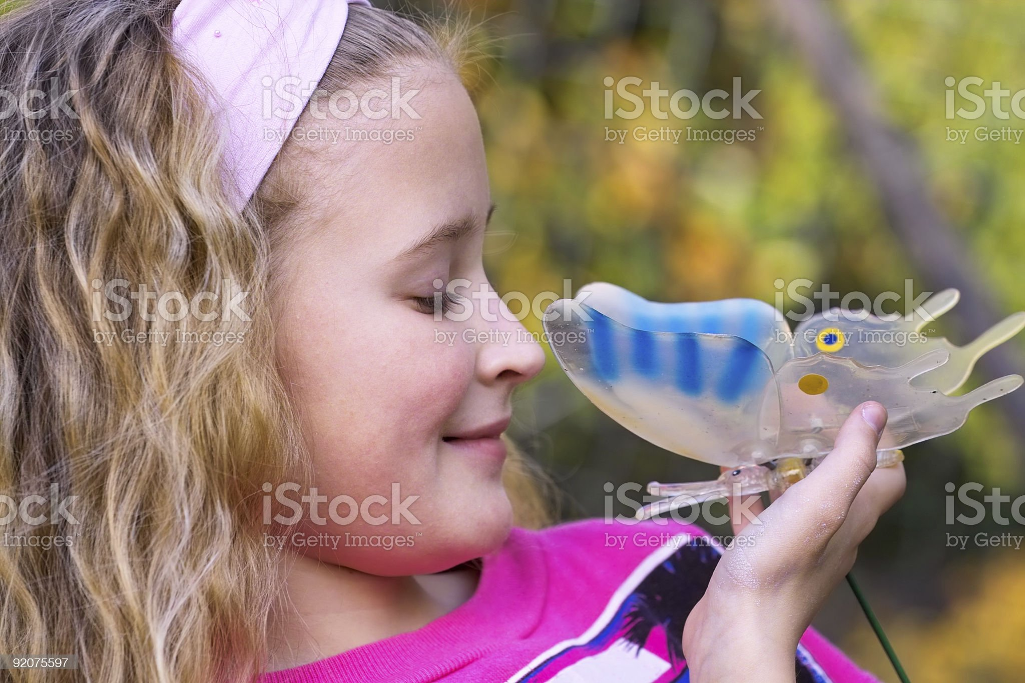 Pretty young girl with butterfly royalty-free stock photo
