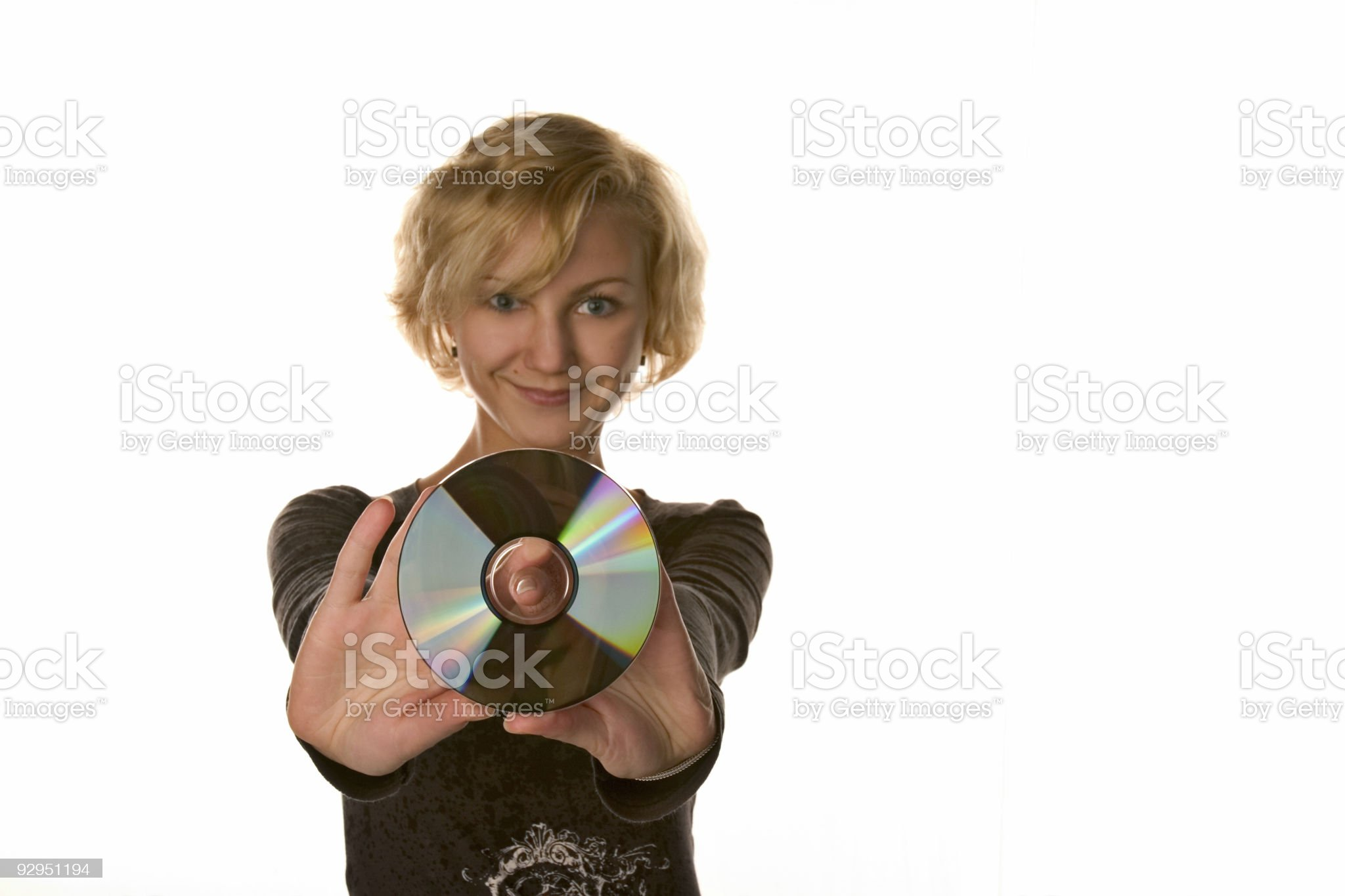 Pretty young girl with CD or DVD disc royalty-free stock photo
