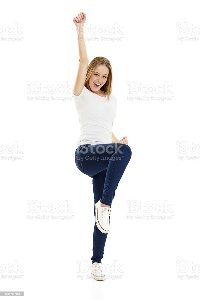 Pretty young girl with her hands raised rejoicing success royalty-free stock photo