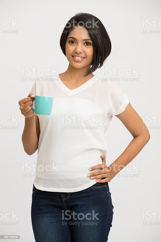 Pretty young Indian girl with coffee cup stock photo