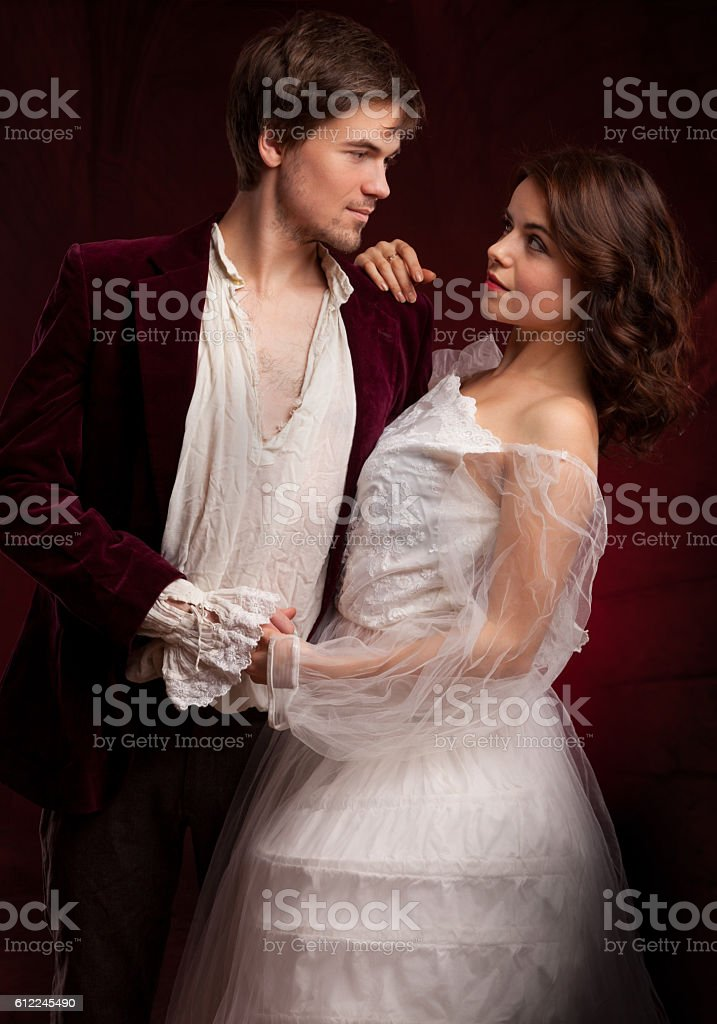 pretty young lady and man in medieval dress stock photo