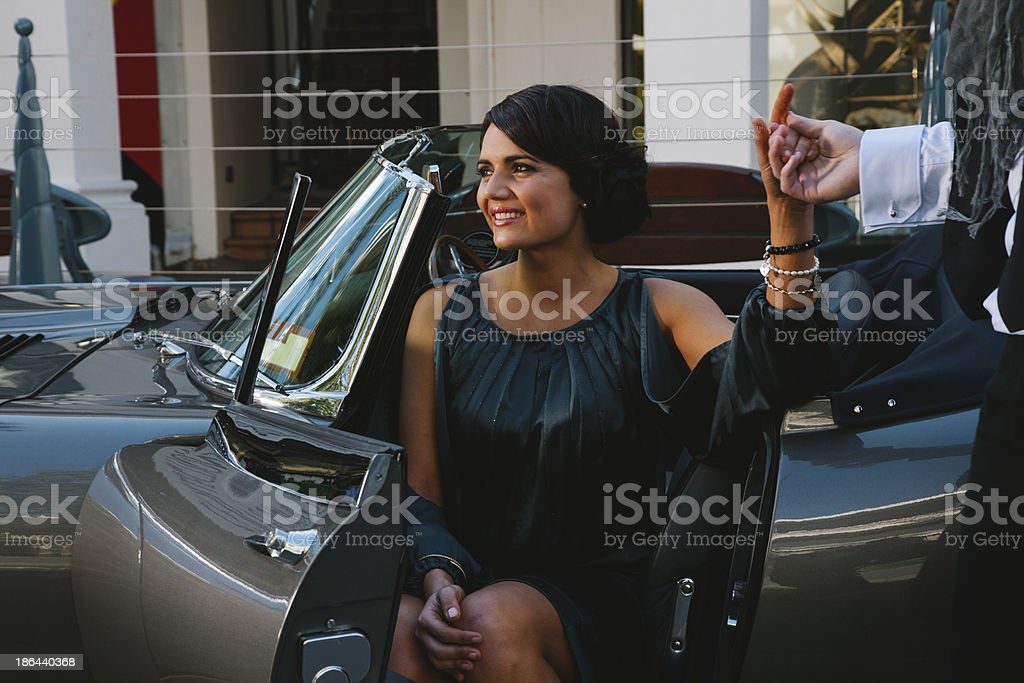 pretty young lady leaving her car stock photo