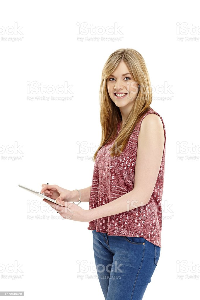 Pretty young lady using digital tablet royalty-free stock photo