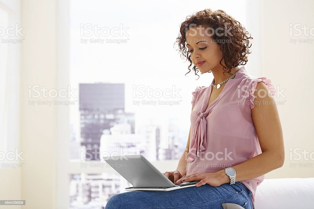 Pretty young lady working on a laptop royalty-free stock photo