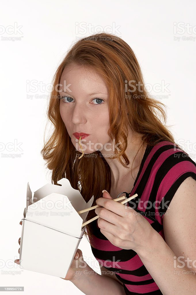 Pretty Young Red Head Slurping Chinese Noodles royalty-free stock photo