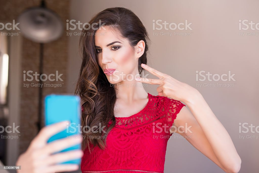 Pretty young sexy fashion woman taking selfie dressed in hipster stock photo