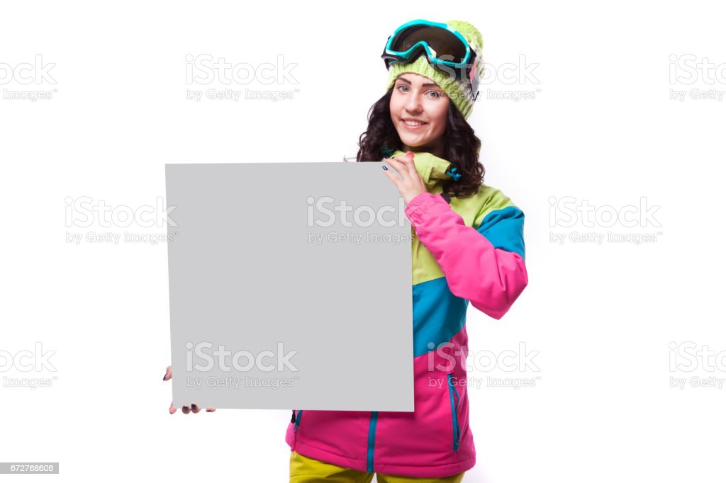 pretty young ski woman hold empty big paper stock photo