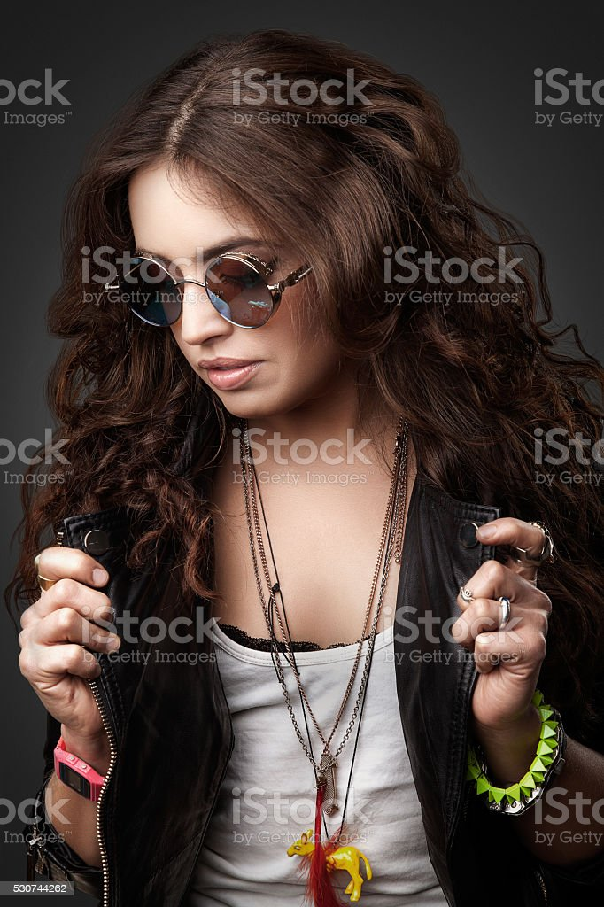 Pretty young stylish girl in black leather jacket and sunglasses stock photo