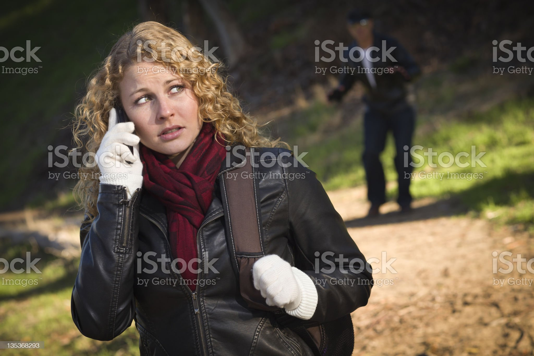 Pretty Young Teen Girl Walking with Man Lurking Behind Her royalty-free stock photo