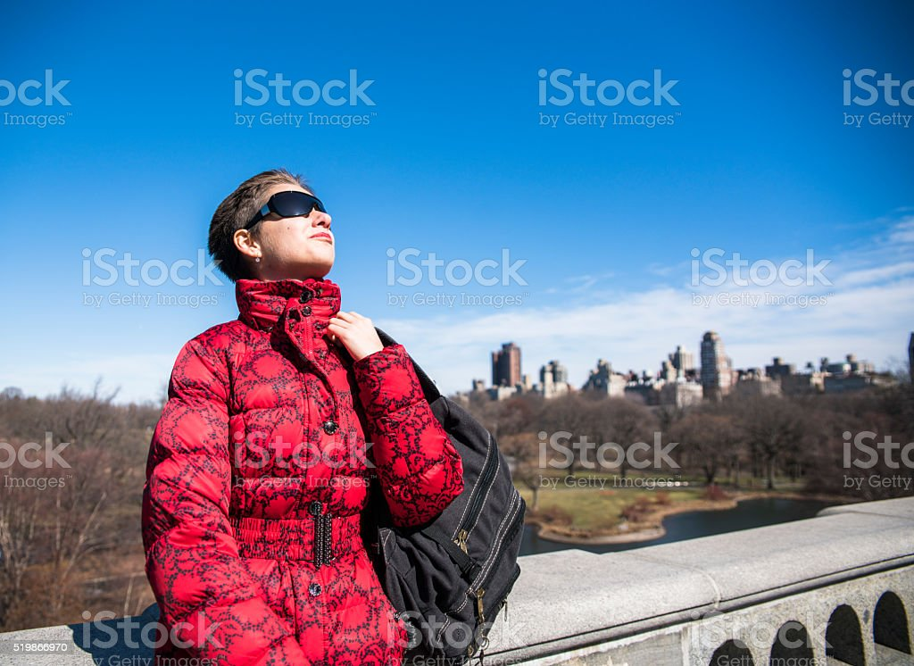 Pretty young woman at the Belvedere Castle in Central Park stock photo