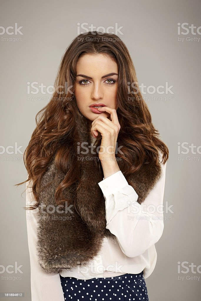 Pretty young woman biting fingernails royalty-free stock photo