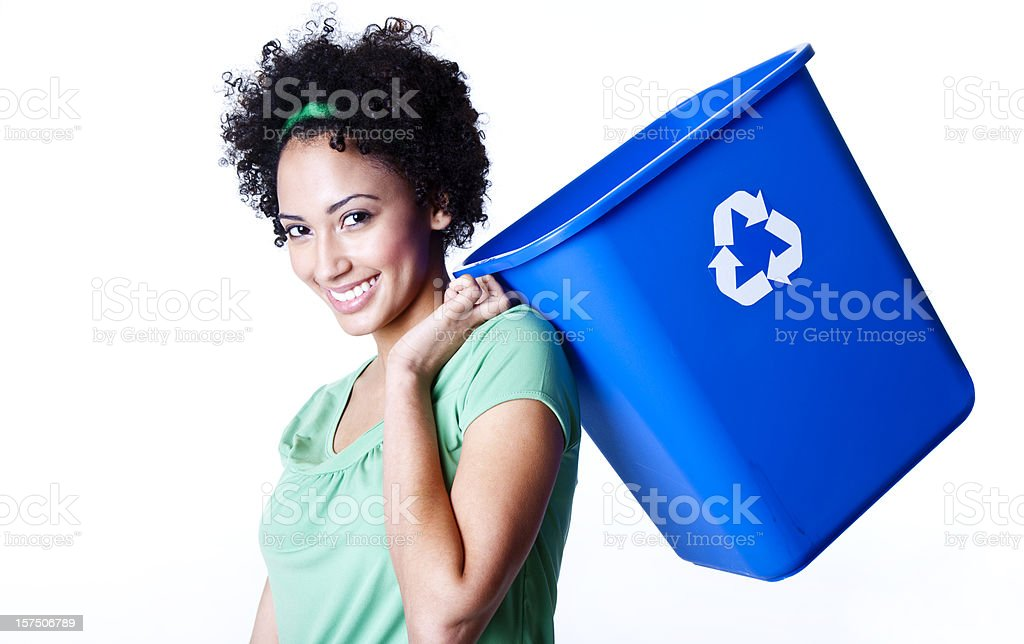pretty young woman carrying recycling bin over her shoulder stock photo