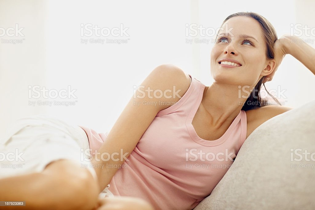 Pretty young woman day dreaming royalty-free stock photo
