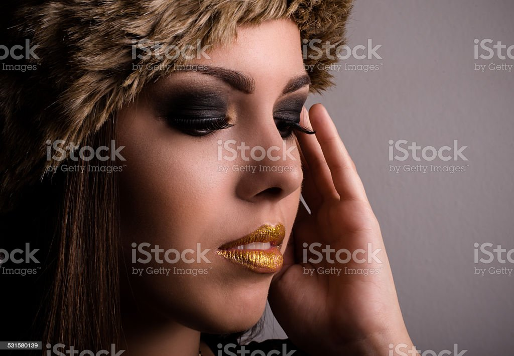 Pretty young woman displaying her eye makeup stock photo