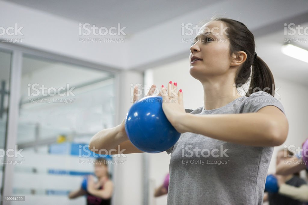 Pretty young woman doing pilates stock photo