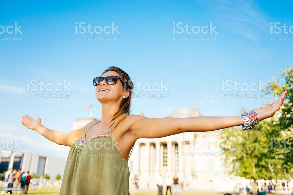Pretty young woman feeling relaxed near Bundestag in Berlin stock photo