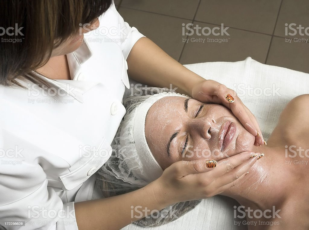Pretty young woman having face massage royalty-free stock photo