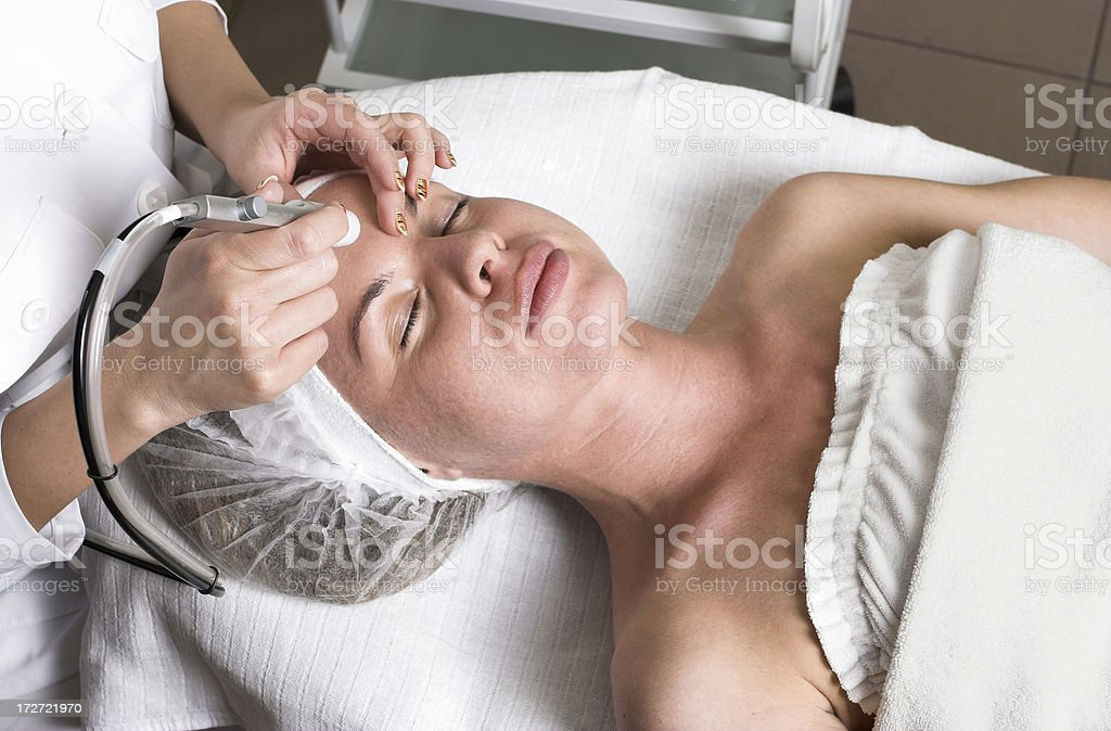 Pretty young woman having relaxing vitalizing face treatment royalty-free stock photo