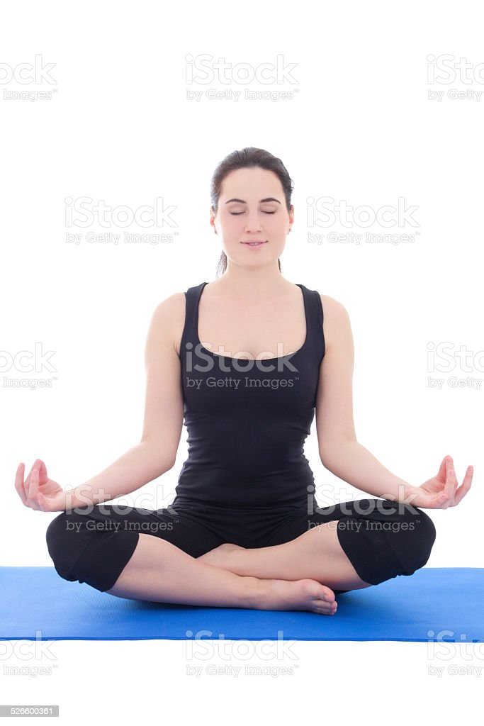 pretty young woman in a meditative yoga pose stock photo