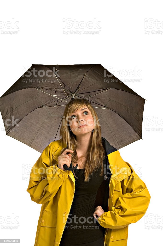 Pretty young woman in a raincoat with umbrella royalty-free stock photo