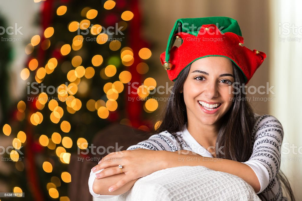 Pretty young woman in elf hat stock photo