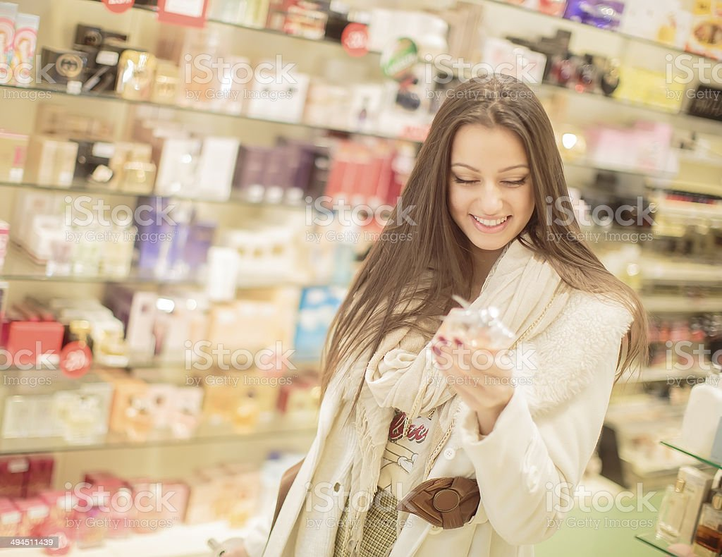 Pretty young woman in perfumery stock photo