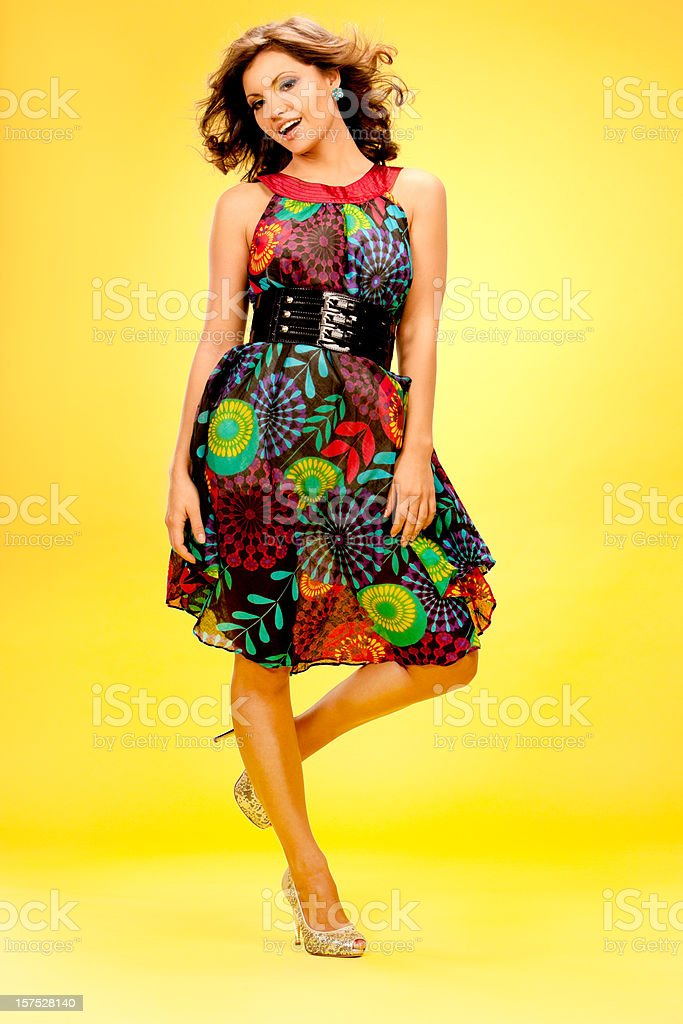 Pretty Young Woman in Summer dress portrait on yellow background royalty-free stock photo