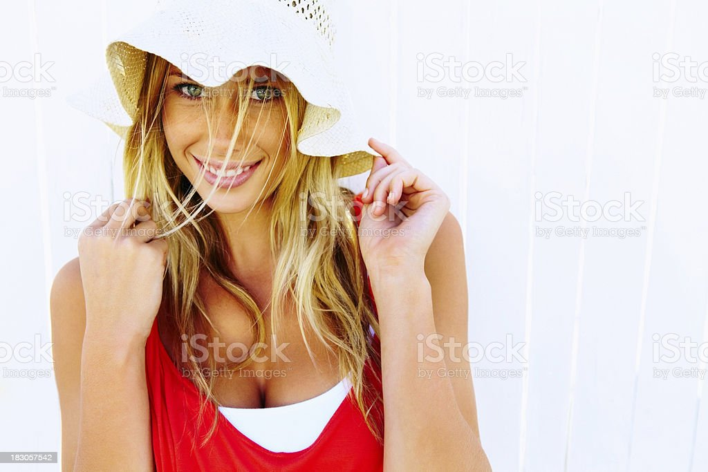 Pretty young woman in sun hat against white royalty-free stock photo