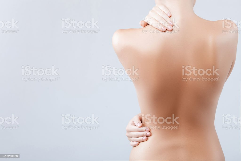 Pretty young woman is caring of her skin stock photo
