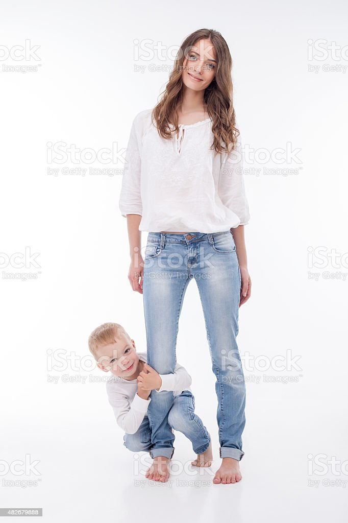 Pretty young woman is playing with her kid stock photo
