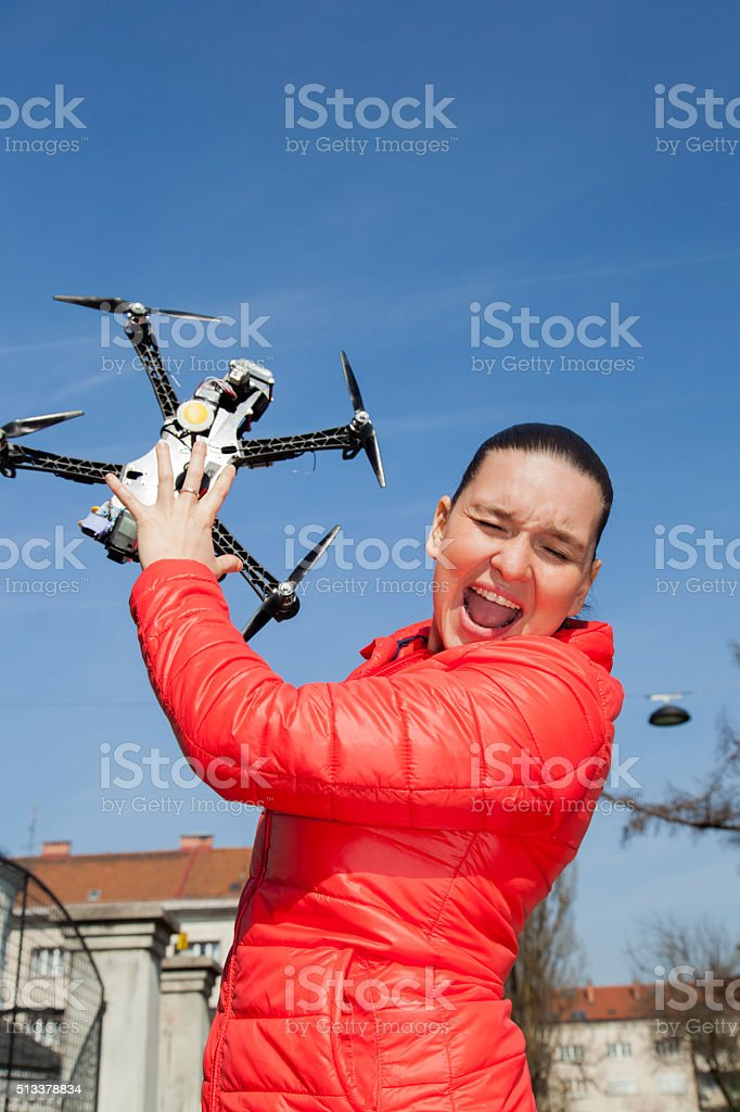 Pretty young woman just a moment before drone attack stock photo