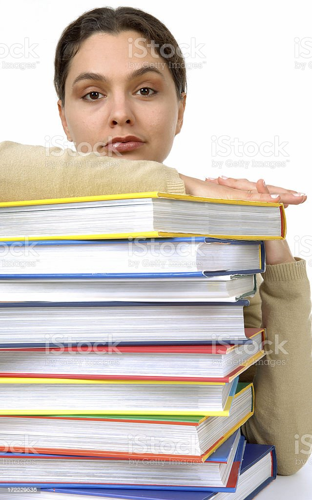pretty young woman leaning on a books stack royalty-free stock photo