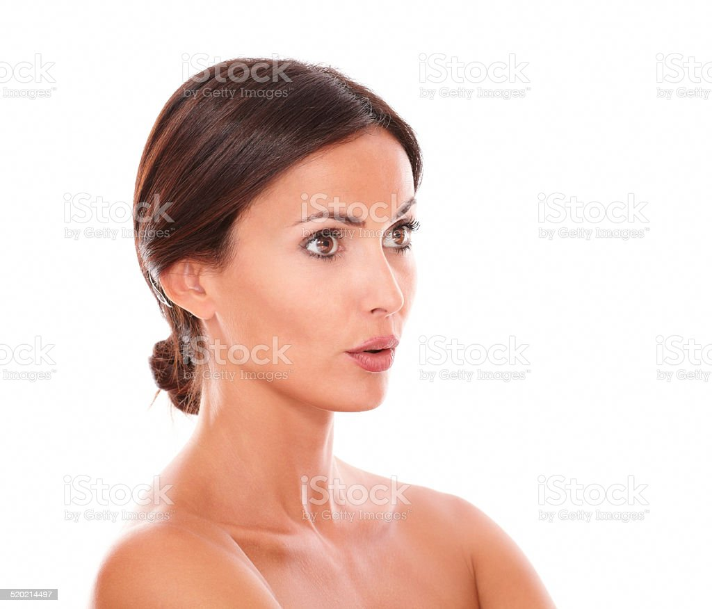 Pretty young woman looking to her left stock photo