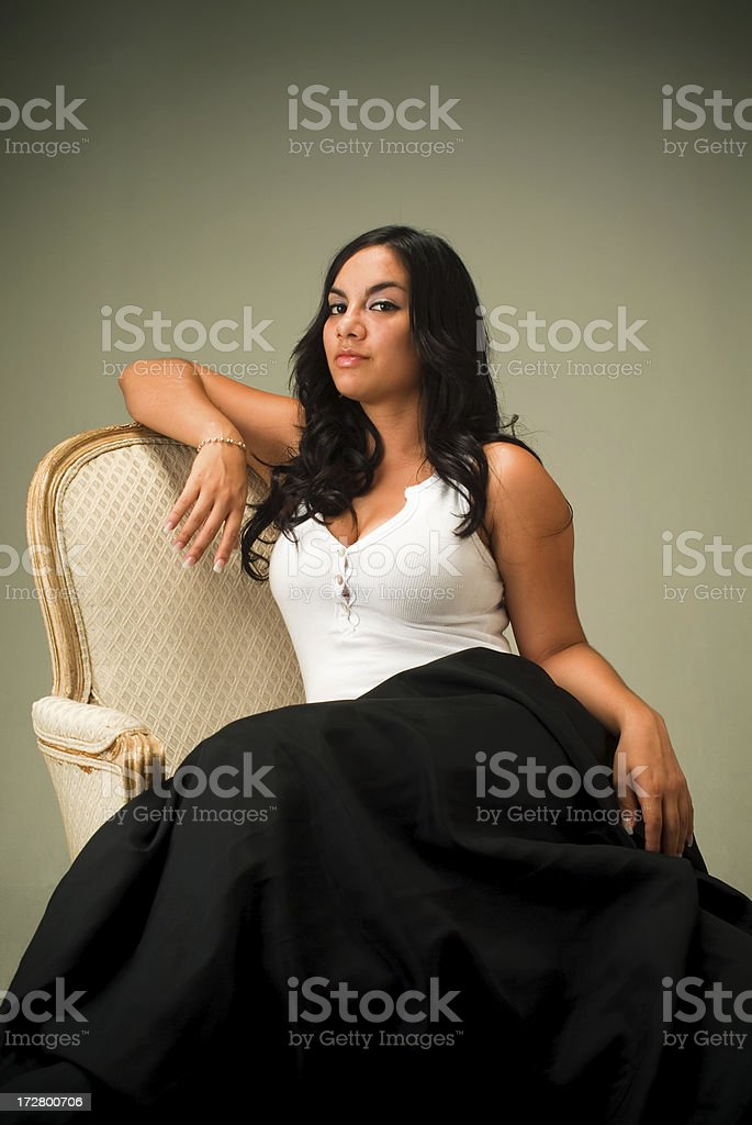 Pretty young woman on chair stock photo