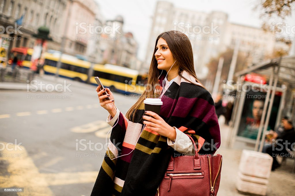 Pretty young woman on the city street stock photo