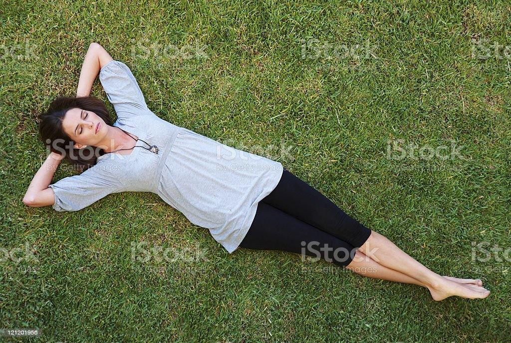 Pretty young woman resting on grass royalty-free stock photo