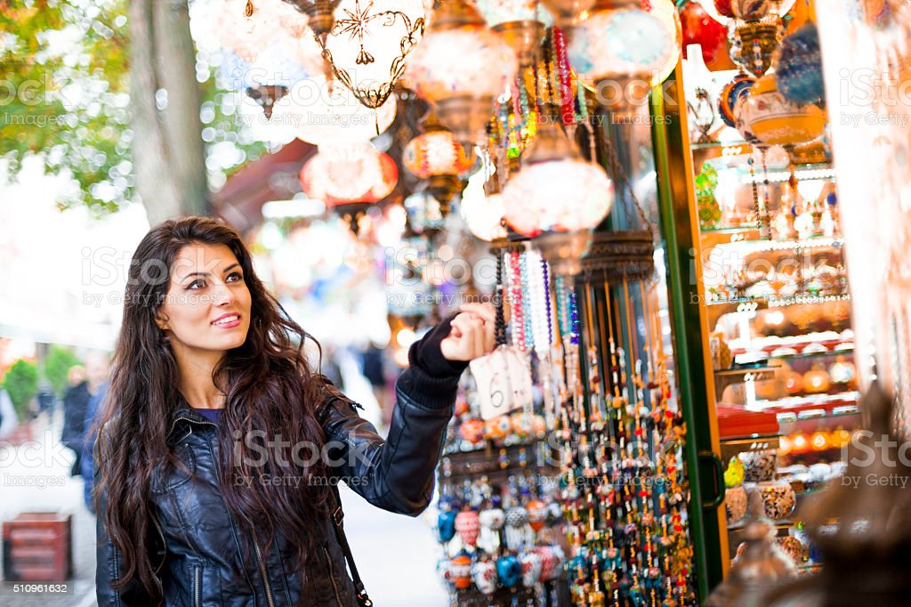 Pretty Young Woman Shopping for Turkish Souvenirs stock photo