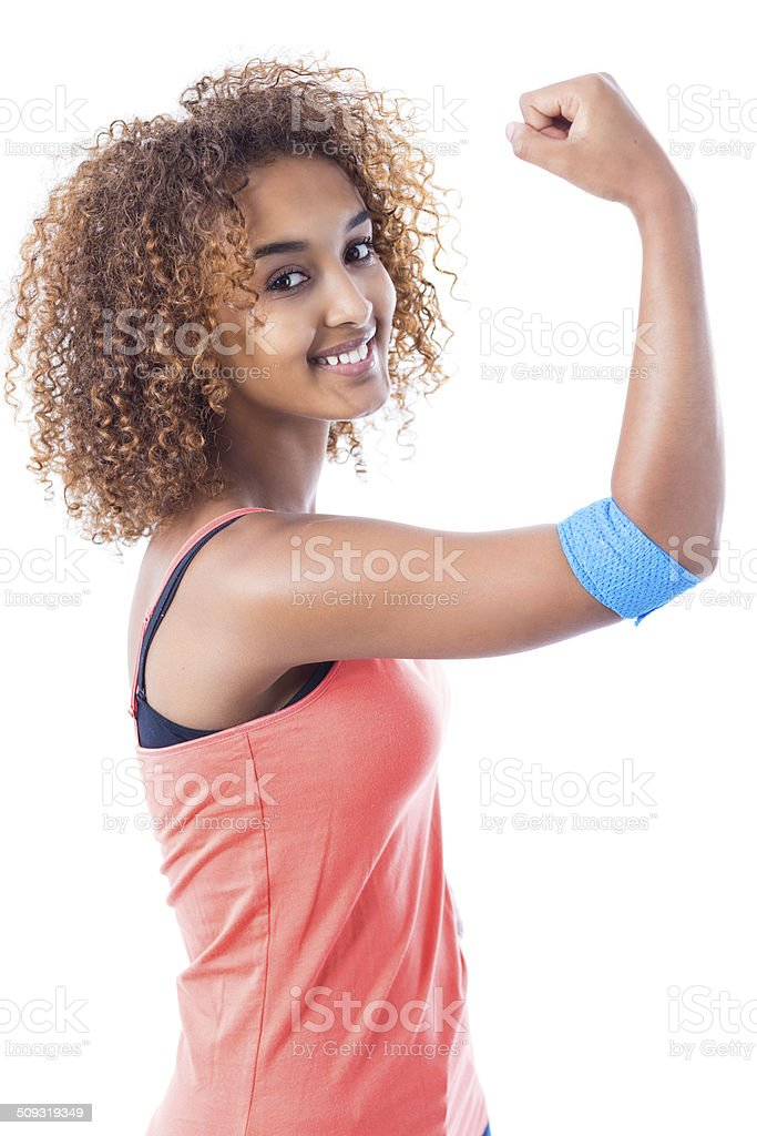 Pretty young woman showing muscles and bandage after donating blood stock photo
