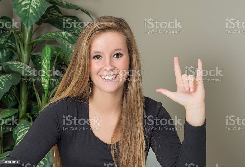 Pretty young woman signing I love you stock photo
