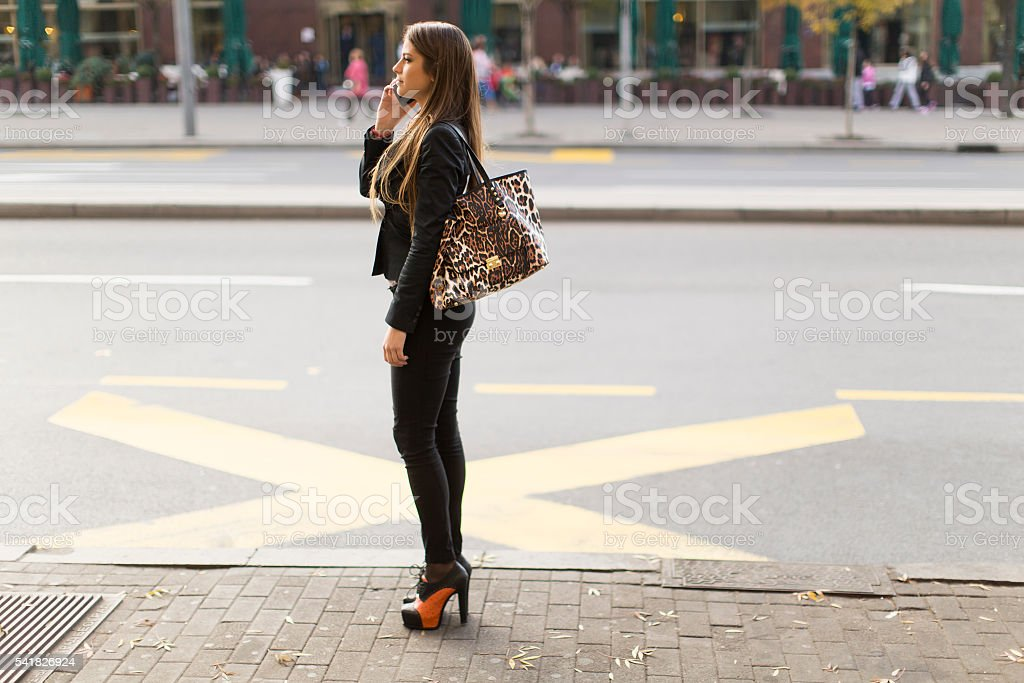 Pretty young woman talking on the mobile phone stock photo