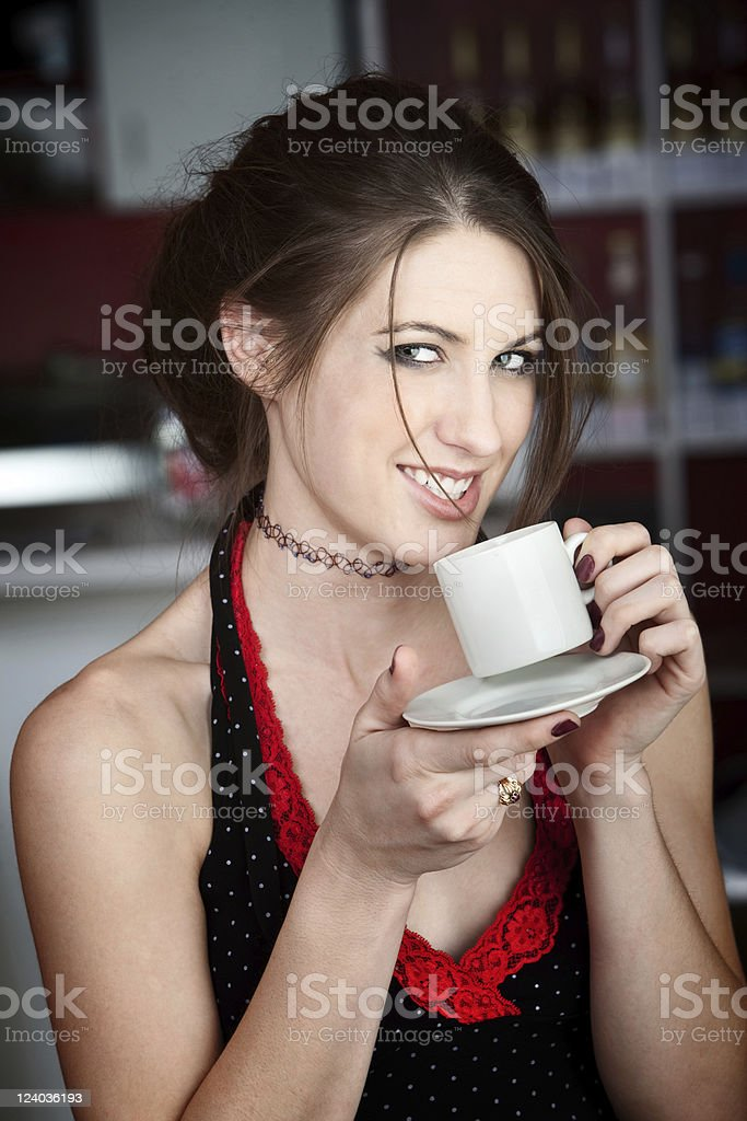 Pretty Young Woman Tasting Coffee royalty-free stock photo