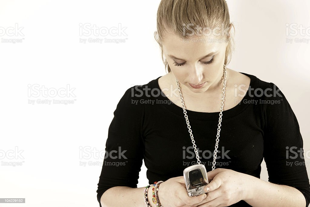 pretty young woman texting stock photo
