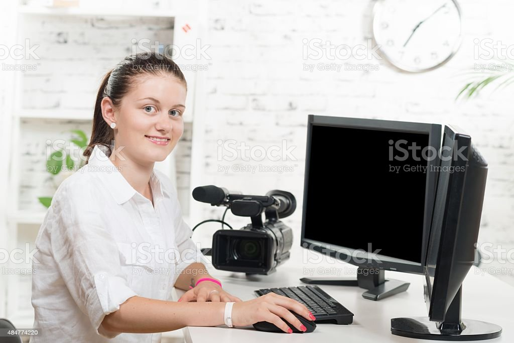 pretty young woman video editor stock photo