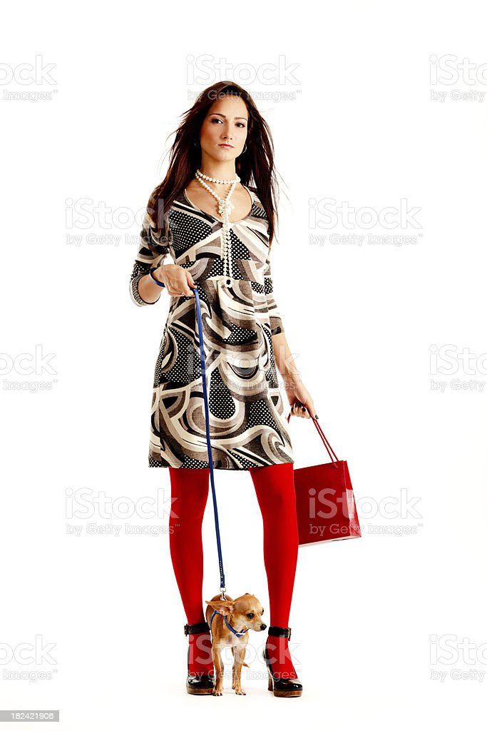 Pretty Young Woman walking her lovely chihuahua royalty-free stock photo