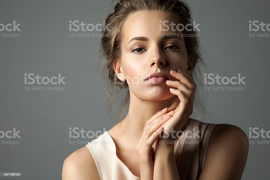 Pretty young woman watching at camera stock photo