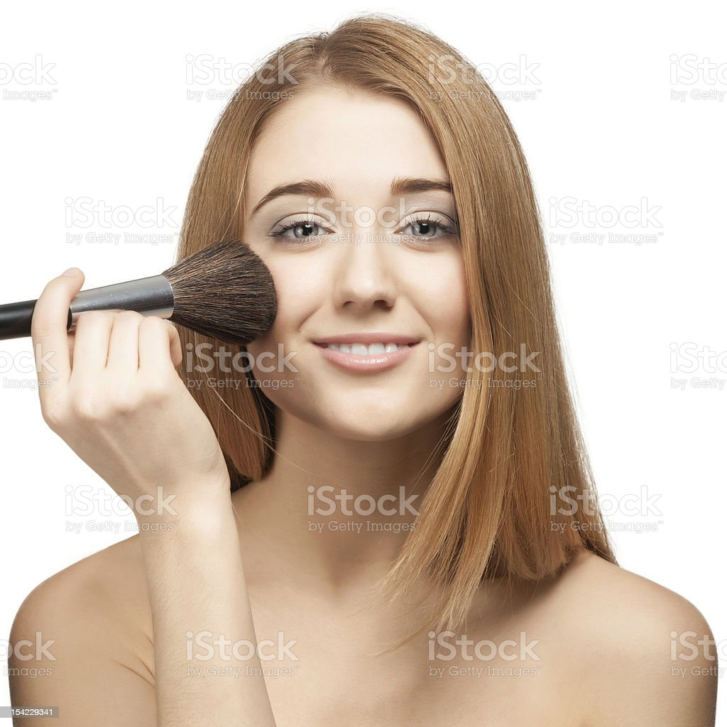 Pretty young woman with brush for makeup royalty-free stock photo