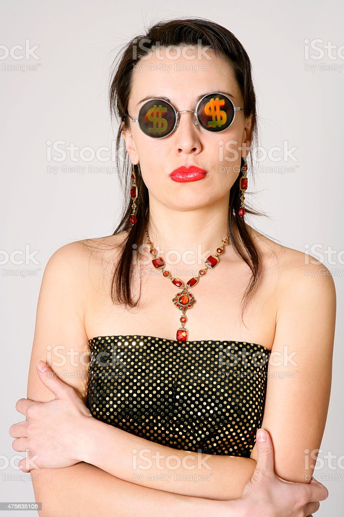 Pretty young woman with dollar signs at her glasses stock photo